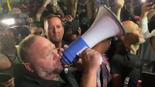 Alex Jones with protesters