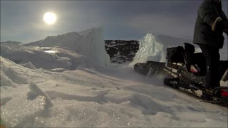 Driving Snowmobile Through Iceberg
