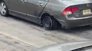 Car Drives Along Interstate on the Rim