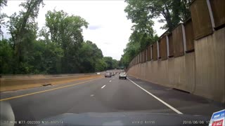 Runaway Tire Smashes Into Oncoming Traffic
