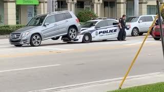 Cop Car Stuck Underneath SUV After Collision