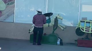 Little Dog Rides Mechanical Horse