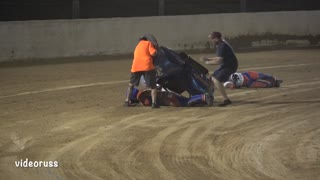 Sidecar Tumbles during Speedway Race