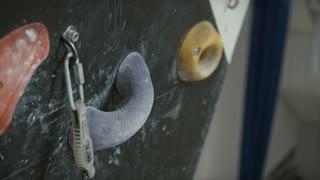 Close-up Shot of a Man's Hands Holding Wall Climbing Grips