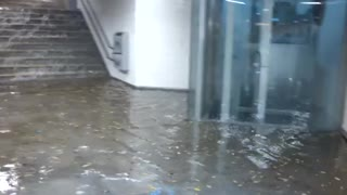 Flood waters going down stairs into subway