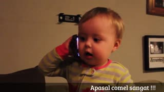 funny baby makes a call