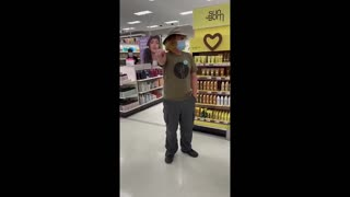 """Man With """"Vaccinated"""" Badge Follows Woman Around Store To Put Her Mask On"""
