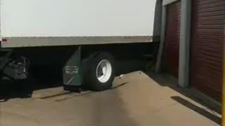 Truck Tears Apart Storage Lockers