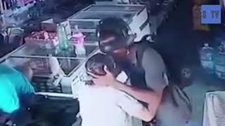Armed robber kisses elderly woman