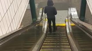 Man walking on escalator going backwards