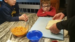 Grandsons Making Pizza Egg Rolls