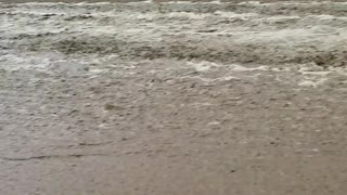 Flood Waters Spill Over onto California Highway