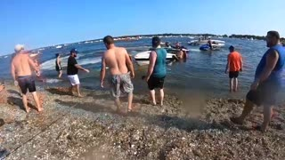 Beach Goers Band Together to Save a Boat