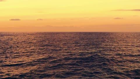 Ocean Horizon Yellow Clouds In Sunset View Water