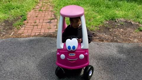 Girl in baby car