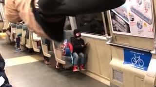 Man pink sweater black and white pants dancing train