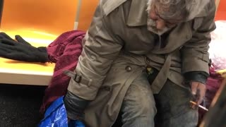 Old man smoking on subway train, drinks bottle of snapple