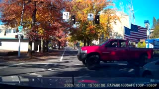 Truck with Trump Flag Runs Red Light