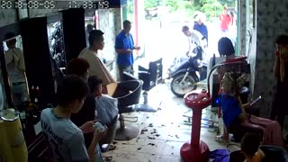 Out of Control Scooter Smashes Into Barbershop