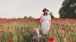 Mom and Daughter Walking on Red Poppy Flower Field