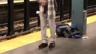 Man sunglasses scarf dancing subway train platform