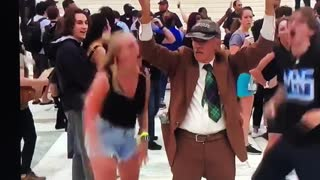 Young Woman Slaps Elderly Man's Sign