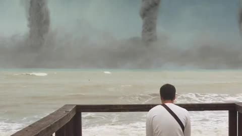 Man sitting and watching tornadoes on the horizon
