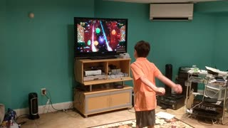 Spencer playing fruit ninja VID_20180804_194854