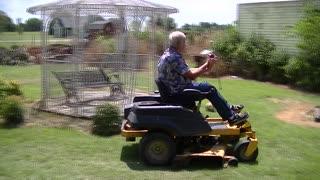 Man Twirls Baton while Mowing! Viral Video!