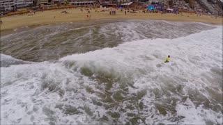 Surfing in Renaca beach in Chile