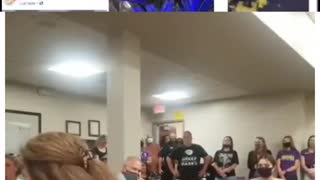 Angry parent at a school board meeting