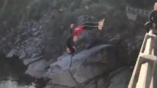 Dude jumps off bridge, performs epic cliff dive