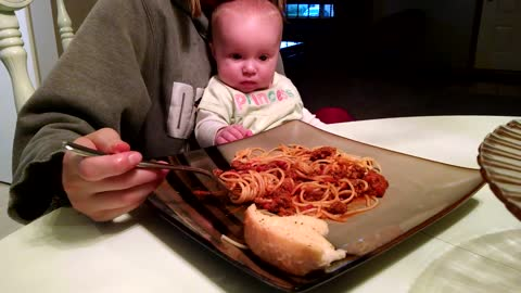Adorable Baby Girl Demands Mom To Feed Her Spaghetti