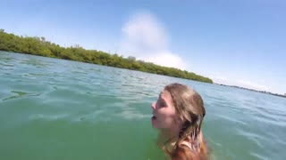 Girl getting attacked by a manatee