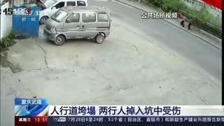 China: Duas pessoas \'engolidas\' em desabamento de passeio sobrevivem