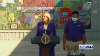 A confused-looking Joe Biden wanders off during his wife's speech