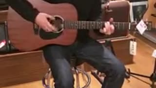 His new guitar