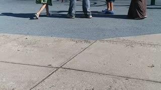Woman Seen Kicking Child