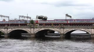 Photographer Under Bridge Taking Records Of Vehicles traveling over a bridge