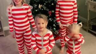 Children dance celebrating Christmas