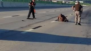 Police Approach Man in Underwear on Highway
