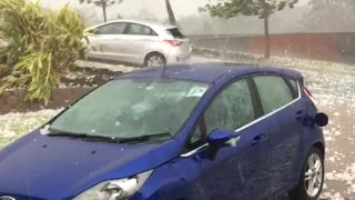Surprise Hail Storm Smashes Car in Seconds