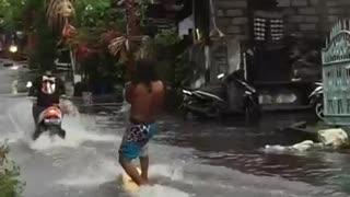 Surfer Enjoys the Rainy Season