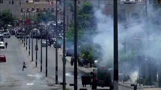 Israeli forces fire teargas at protestors
