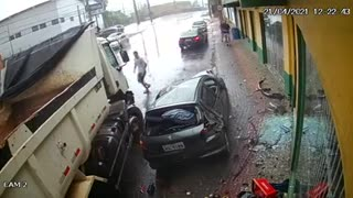 truck crashes into car stopped in parking lot