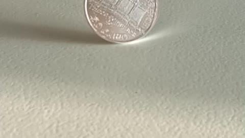 1oz silvercoin spinning slow motion