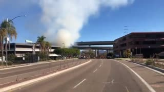 2500 Camino Del Rio W. Is closed in both directions due to a brush fire.
