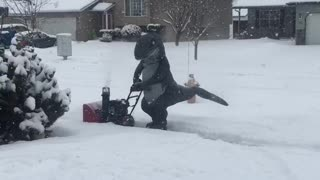 Velociraptor Fights Ice Age One Driveway at a Time