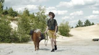 Boy Walking Beside A Horse