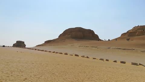 Italian Tourists Climbing El Modawara Mountain In Egypt